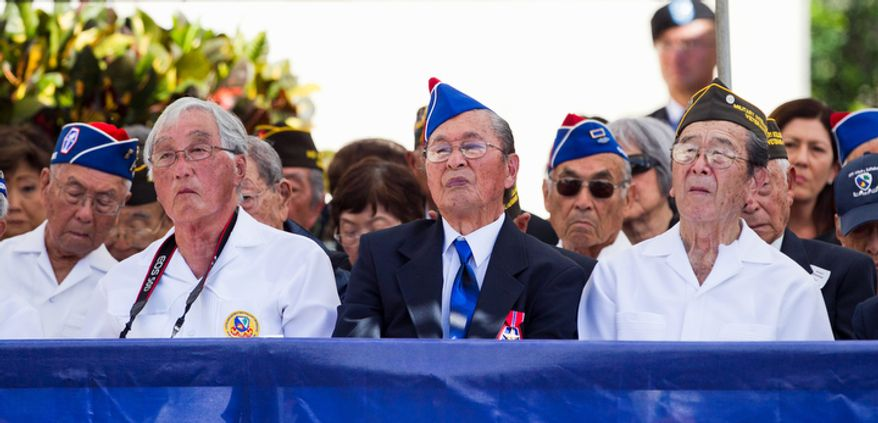 Veterans of the 442nd Regimental Combat Team Battalion attend the memorial service for U.S. Sen. Daniel Inouye, D-Hawaii at the National Memorial Cemetery of the Pacific, Sunday, Dec. 23, 2012 in Honolulu. Inouye was part of the 442nd which fought in Europe during World War II. (AP Photo/Marco Garcia)