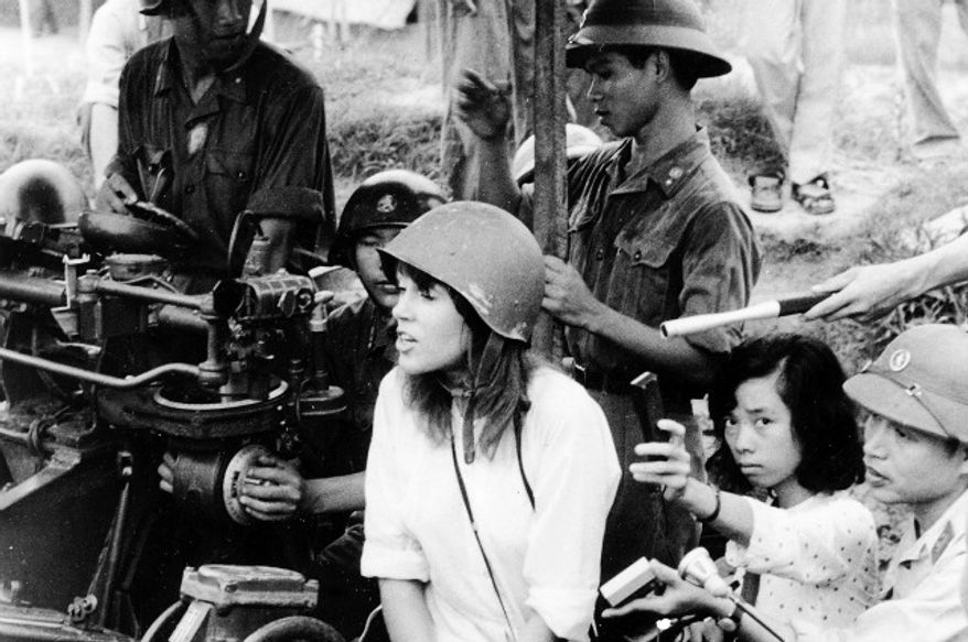 American actress and activist Jane Fonda is surrounded by soldiers and reporters as she sings an anti-war song near Hanoi during the Vietnam War in July 1972. (Photograph by Associated Press)