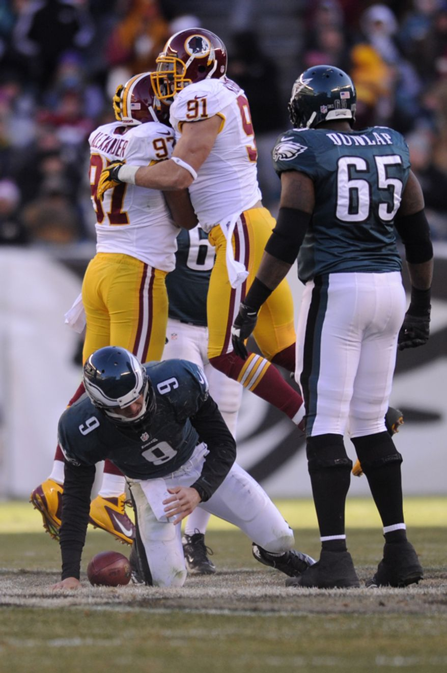 Washington Redskins linebacker Lorenzo Alexander (97) is congratulated by outside linebacker Ryan Kerrigan (91) after sacking Philadelphia Eagles quarterback Nick Foles (9) in the third quarter at Lincoln Financial Field, Philadelphia, Pa., Dec. 23, 2012. (Preston Keres/Special to The Washington Times)