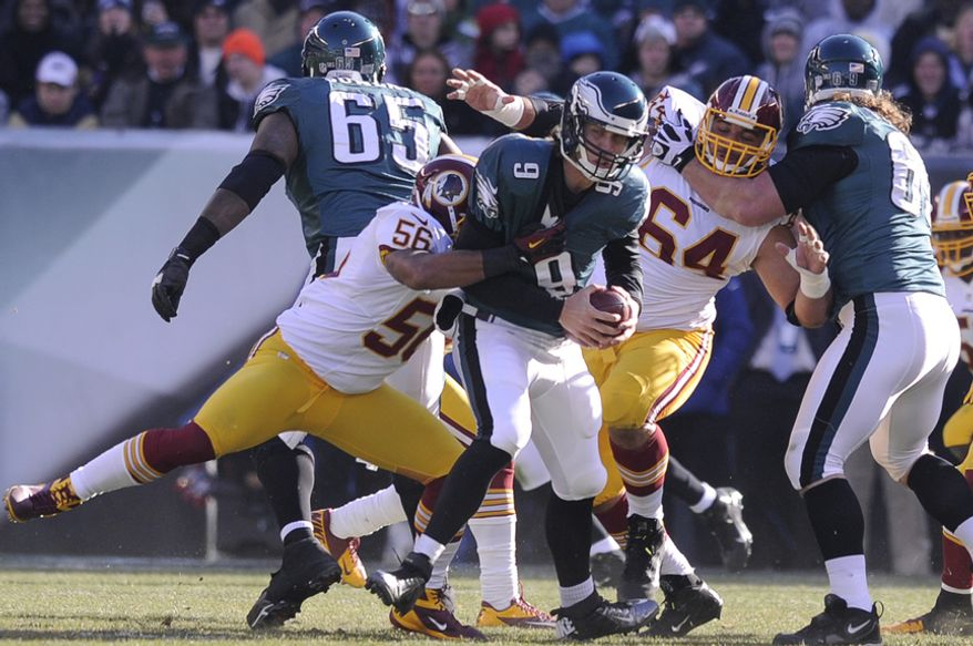 Washington Redskins inside linebacker Perry Riley (56) sacks Philadelphia Eagles quarterback Nick Foles (9) for an 8-yard loss in the first quarter at Lincoln Financial Field, Philadelphia, Pa., Dec. 23, 2012. (Preston Keres/Special to The Washington Times)