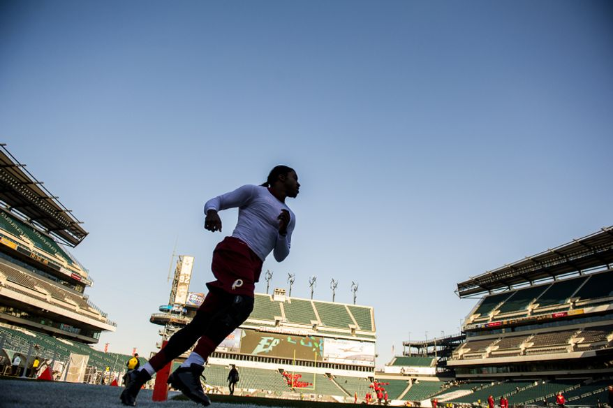 Washington Redskins quarterback Robert Griffin III (10) warms up before the Washington Redskins play the Philadelphia Eagles at Lincoln Financial Field, Philadelphia, Pa., Sunday, December 23, 2012. (Andrew Harnik/The Washington Times)