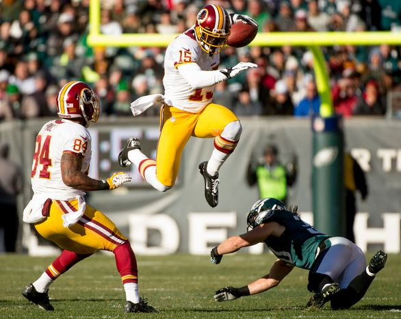 Washington Redskins wide receiver Josh Morgan (15) jumps over a defender as he runs after the pass for 7 yards in the second quarter as the Washington Redskins play the Philadelphia Eagles at Lincoln Financial Field, Philadelphia, Pa., Sunday, December 23, 2012. (Andrew Harnik/The Washington Times)
