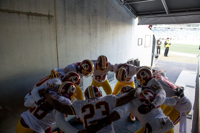 Washington Redskins players huddle in their tunnel before taking the field as the Washington Redskins play the Philadelphia Eagles at Lincoln Financial Field, Philadelphia, Pa., Sunday, December 23, 2012. (Andrew Harnik/The Washington Times)