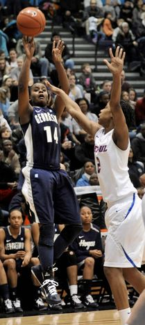 Georgetown's Sugar Rodgers left, goes up for a shot against DePaul's Taylor Pikes in the second half during an NCAA college basketball game in Chicago, Sunday, Feb. 20, 2011. DePaul won 82-57. (AP Photo/Paul Beaty)
