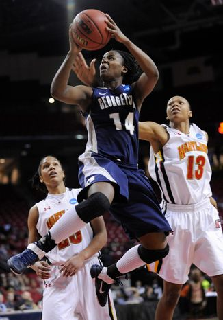 Georgetown's Sugar Rodgers shoots as Maryland's Alicia DeVaugh, right, and Alyssa Thomas defend during the second half of a second-round game in the NCAA women's college basketball tournament Tuesday, March 22, 2011, in College Park, Md. Georgetown won 79-57. (AP Photo/Gail Burton)