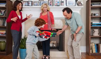 """Billy Crystal gets a water-rifle blast from Kyle Harrison Breitkopf, playing his grandson, in """"Parental Guidance."""" Marisa Tomei (left) and Bette Midler are mother and grandmother, respectively, in a film full of cliches that plays like a TV sitcom stretched into feature length. Kyle and the other child actors are the film's bright spots. (Associated Press)"""