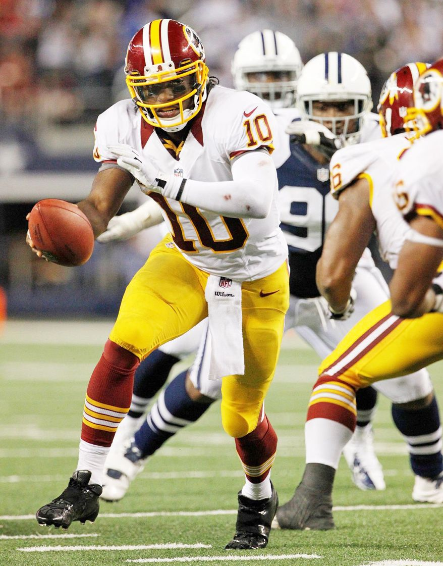 Robert Griffin III can lead the Redskins to the NFC East title with a win over the Cowboys on Sunday night. (Associated Press)