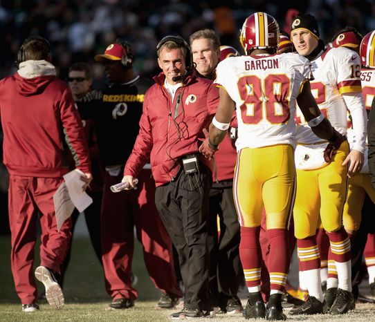 Redskins coach Mike Shanahan (center) is on the verge of taking Washington to the postseason for the first time during his three-year tenure. (Andrew Harnik/The Washington Times)