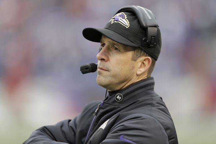 Baltimore Ravens head coach John Harbaugh watches the action of the field during the first half of an NFL football game against the Denver Broncos in Baltimore, Sunday, Dec. 16, 2012. (AP Photo/Patrick Semansky)