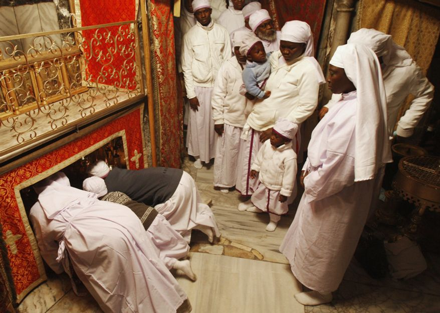 Christian worshippers from Nigeria pray in the Grotto of the Church of Nativity, traditionally believed by Christians to be the birthplace of Jesus Christ, in the West Bank town of Bethlehem, Monday, Dec. 24, 2012. Thousands of Christian worshippers and tourists arrived in Bethlehem on Monday to mark Christmas at the site many believe Jesus Christ was born. (AP Photo/Adel Hana)