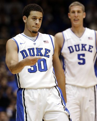 Duke's Seth Curry (30) and Mason Plumlee (5) react following a basket against Cornell during the second half of an NCAA college basketball game in Durham, N.C., Wednesday, Dec. 19, 2012. Duke won 88-47. (AP Photo/Gerry Broome)