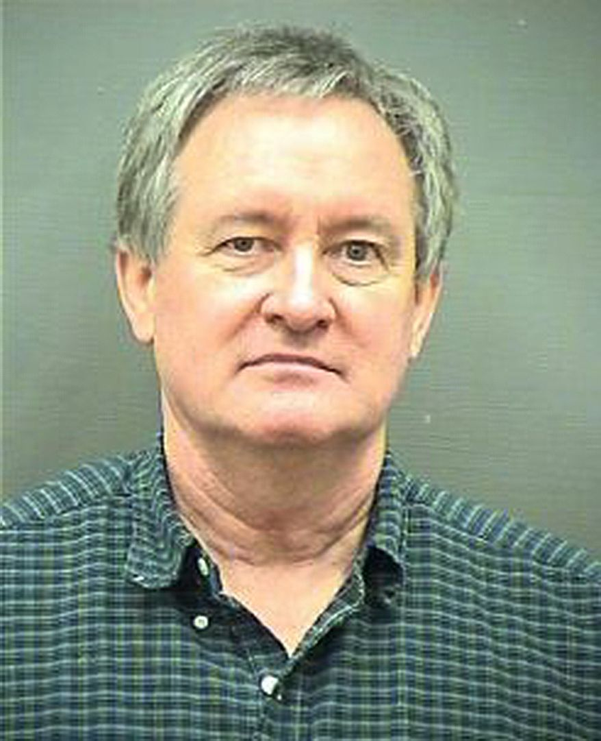 Sen. Michael Crapo, Idaho Republican, is shown in a booking photo after being arrested early Sunday morning, Dec. 23, 2012, and charged with driving under the influence in Alexandria, Va., a Washington suburb. (AP Photo/Alexandria Police Department)