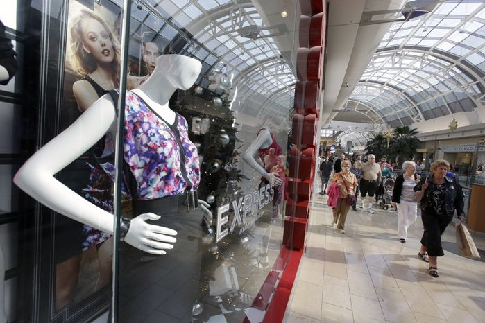 Shoppers walk through a mall in Orlando, Fla., on Thursday, Dec. 20, 2012. (AP Photo/John Raoux)