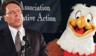 National Rifle Association gun safety mascot Eddie Eagle stands beside Wayne LaPierre, NRA executive vice-president, during a news conference in Washington Friday, Feb. 28, 1997, to mark the third anniversary of the Brady Act. (AP Photo/Dennis Cook)