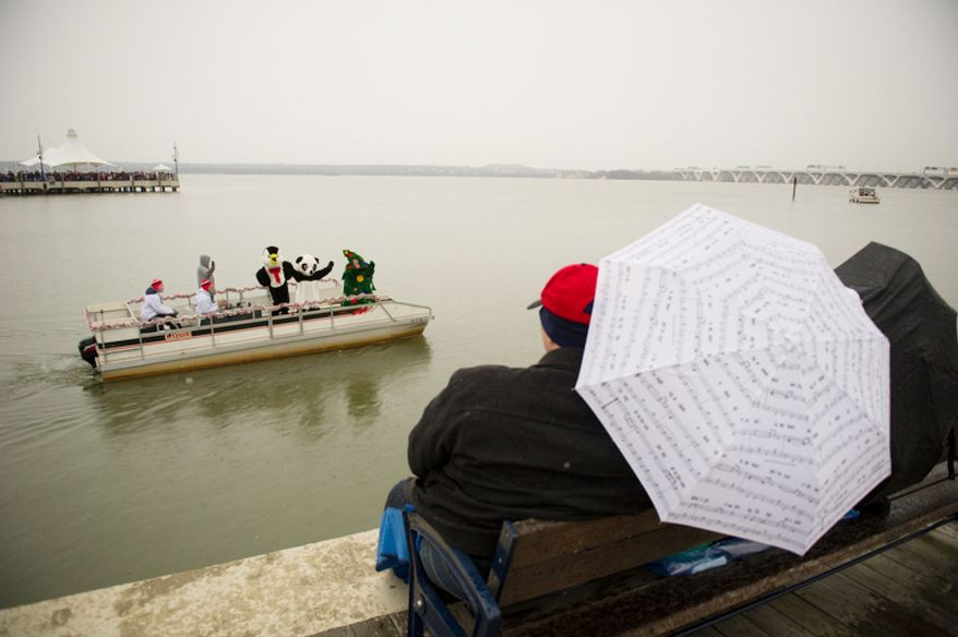 People brave the cold, rain and snow during the 27th annual show of The Water-Skiing Santa.  (Rod Lamkey Jr./The Washington Times)
