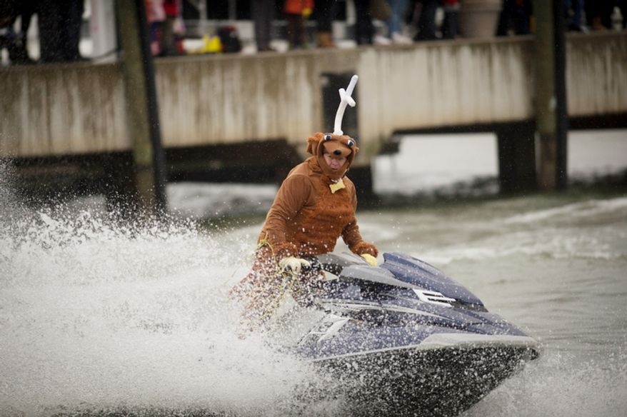 Christmas inspired characters take to the water on jet skis during the 27th annual show of The Water-Skiing Santa.  (Rod Lamkey Jr./The Washington Times)