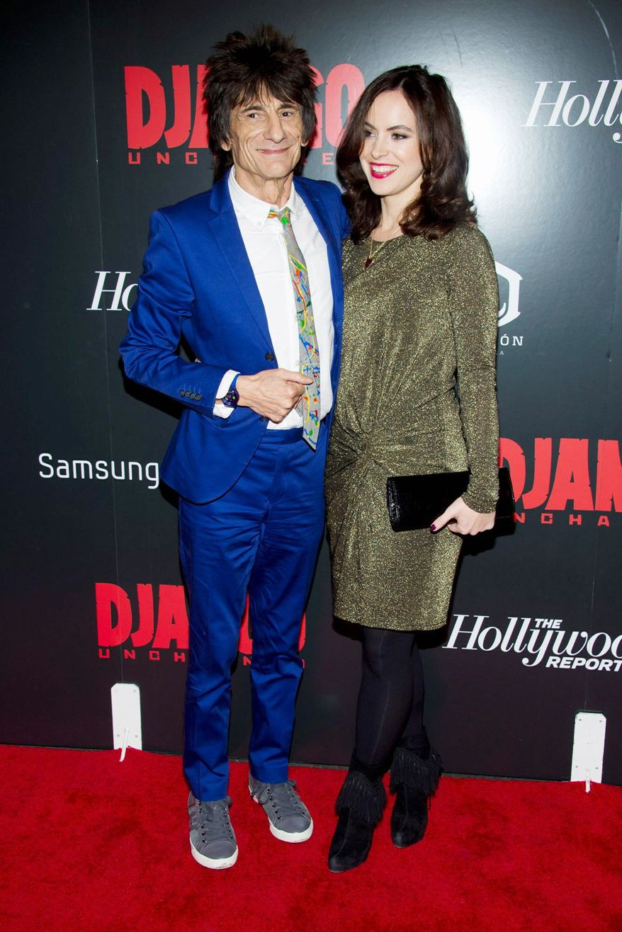 Rolling Stones guitarist Ronnie Wood, 65, and Sally Humphries, 34, a theater producer, got married Friday, Dec. 21, 2012, in a private ceremony in London. (Associated Press)