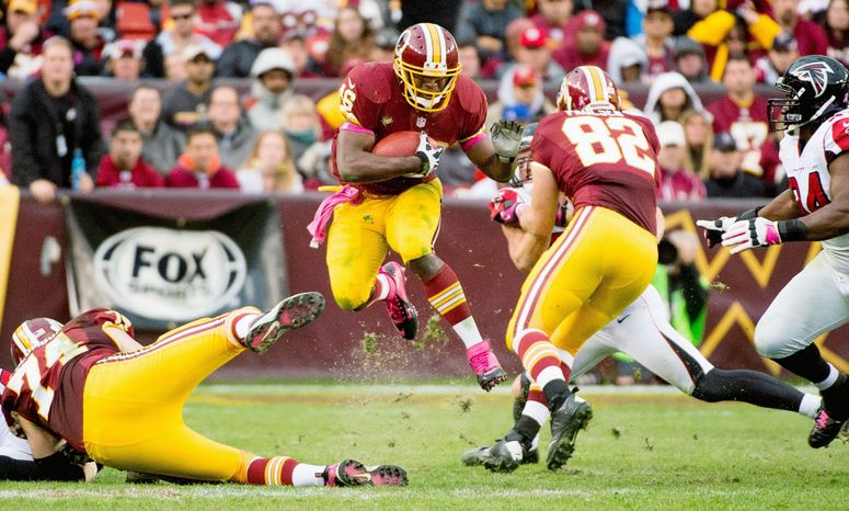 Alfred Morris has rushed for 178 yards and three touchdowns on 49 carries in the past two games, when quarterback Robert Griffin III was sidelined or limited. (Andrew Harnik/The Washington Times)