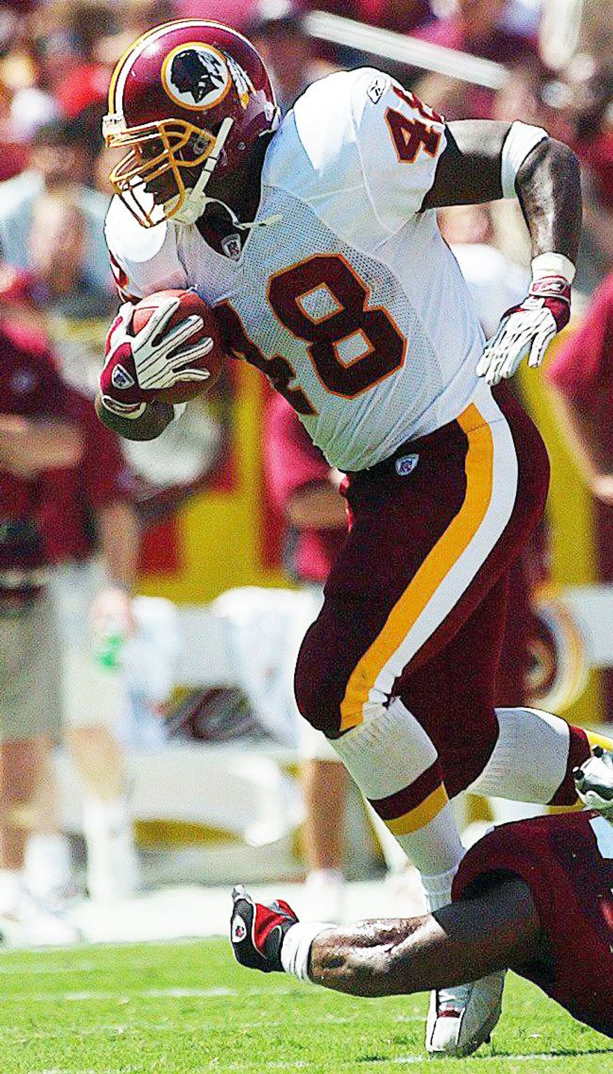 Clinton Portis and Stephen Davis (right) own four of the top five rushing seasons in Redskins history. Rookie Alfred Morris, a sixth-round draft pick, would have the best should he run for 104 yards Sunday night against Dallas. (The Washington Times)