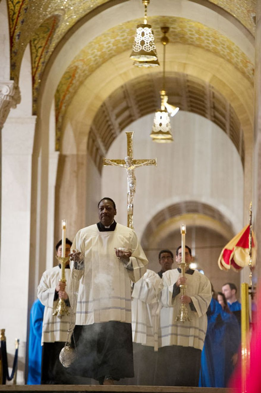A processional begins as the Archbishop of Washington Cardinal Donald Wuerl leads a congregation of 4,000 in Solemn Mass of Christmas Day at the Basilica of the National Shrine of the Immaculate Conception, Washington, D.C., Tuesday, December 25, 2012. (Andrew Harnik/The Washington Times)