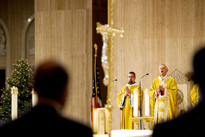 The Archbishop of Washington Cardinal Donald Wuerl, right, begins the Solemn Mass of Christmas Day at the Basilica of the National Shrine of the Immaculate Conception, Washington, D.C., Tuesday, December 25, 2012. (Andrew Harnik/The Washington Times)