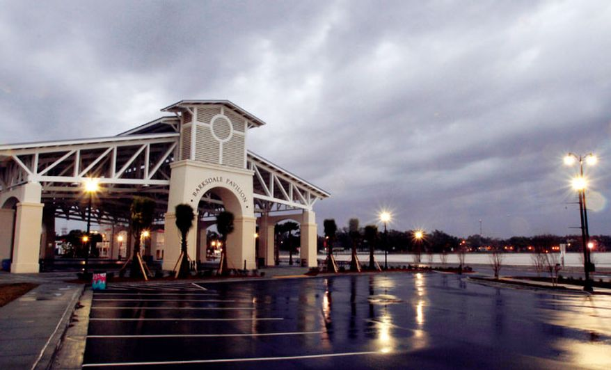 Storm clouds roll past Barksdale Pavilion at Jones Park in Gulfport, Miss., Tuesday, Dec. 25, 2012. After most of spending Christmas Day with a blustery day and occasional blue skies, storm clouds arrived on the Coast at 4 p. m. The strong south breeze blew most of the bad weather north of the immediate coast line. (AP Photo/The Sun Herald, Tim Isbell)