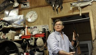 Taxidermist Bill Moos displays one of his shotguns in his shop in Bryan, Texas, on Wednesday, Dec. 19, 2012.  Mr. Moos, who owns more than 30 guns, can be spotted any given morning, prowling his roughly 40-acre ranch with his dogs and a shotgun slung over his shoulder. (AP Photo/Pat Sullivan)