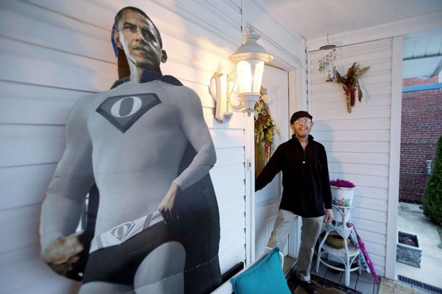 In this Thursday, Dec. 20, 2012, photo, Gerald Duval, innkeeper of the Aunt Bea's Little White House B&B, stands in the doorway by a cutout of President Barack Obama in a superhero outfit, at the B&B in Washington. The six-room bed and breakfast in Northeast Washington still had two rooms available for the presidential inauguration as of the week before Christmas, with rates starting at $225 a night. (AP Photo/Jacquelyn Martin)