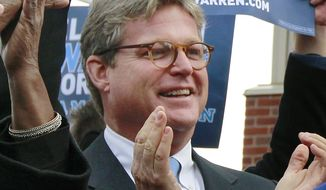 Edward Kennedy Jr., son of the late Sen. Edward M. Kennedy, applauds during a campaign event in Boston for Senate candidate Elizabeth Warren on Monday, Nov. 5, 2012. (AP Photo/Steven Senne)