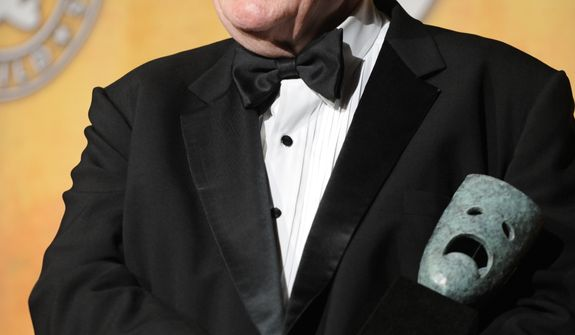 Charles Durning holds his Life Achievement Award at the 14th annual Screen Actors Guild Awards in Los Angeles in 2008. (Associated Press)