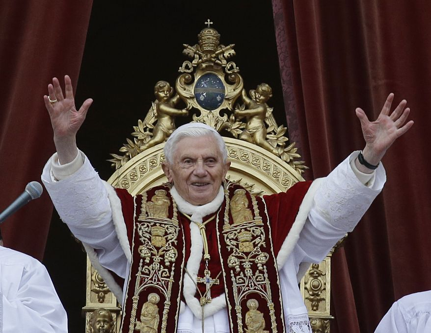 """Pope Benedict XVI delivers his """"Urbi et Orbi"""" (""""To the City and to the World"""") address from the central loggia of St. Peter's Basilica at the Vatican in this Tuesday, Dec. 25, 2012, file photo. (AP Photo/Gregorio Borgia) ** FILE **"""