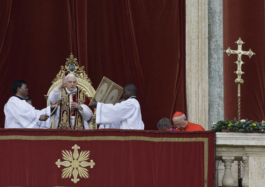 """Pope Benedict XVI delivers his """"Urbi et Orbi"""" ('To the City and to the World"""") speech from the central loggia of St. Peter's Basilica at the Vatican on Tuesday, Dec. 25, 2012. (AP Photo/Gregorio Borgia)"""