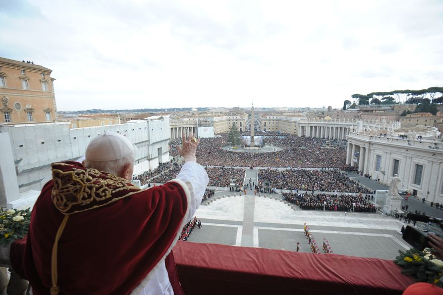 "Pope Benedict XVI delivers his ""Urbi et Orbi"" (""To the City and to the World"") Christmas message from the central balcony of St. Peter's Basilica at the Vatican on Tuesday, Dec. 25, 2012. (AP Photo/Gregorio Borgia)"