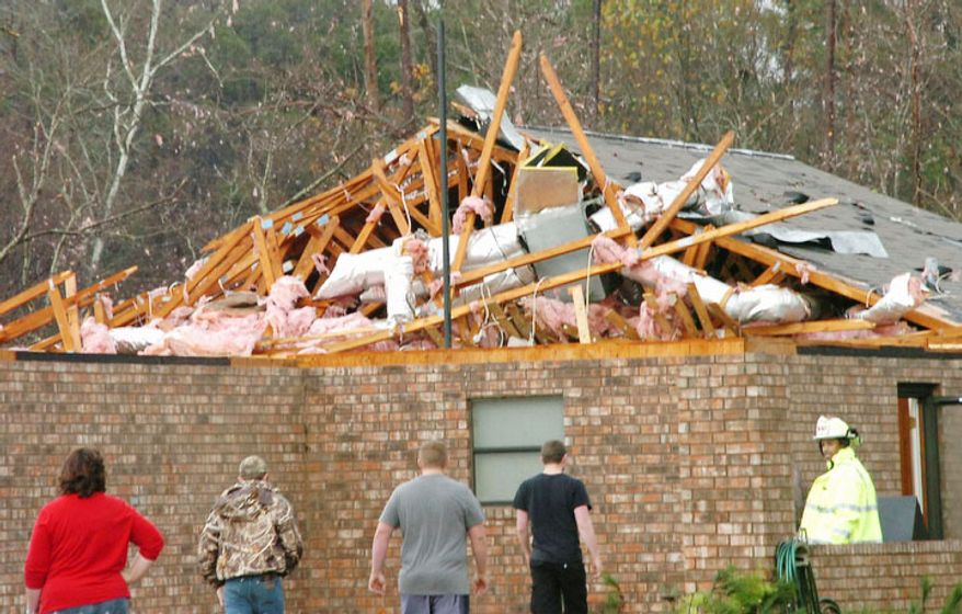 A house in Tioga, La., is severely damaged after an apparent tornado tore through the area Tuesday, Dec. 25, 2012. (AP Photo/The Daily Town Talk, Melinda Martinez)