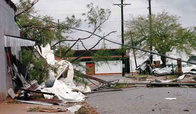 Debris sits on a side street near Washington Street in Alexandria, La. after an apparent tornado tore through the area Tuesday, Dec. 25, 2012. (AP Photo/The Daily Town Talk, Melinda Martinez)