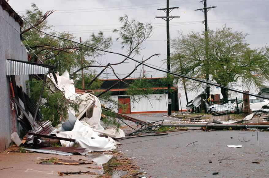 Debris sits on a side street near Washington Street in Alexandria, La. after an apparent tornado tore through the area Tuesday, Dec. 25, 2012. (AP Photo/The Daily Town Talk, Melinda Martinez)