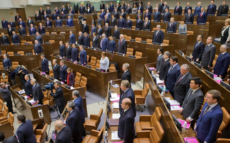 Federation Council members listen to the national anthem at a session opening in the Russian parliament's upper chamber in Moscow on Dec. 26, 2012. The upper chamber unanimously voted in favor of a measure banning Americans from adopting Russian children. It now goes to President Vladimir Putin to sign or turn down. (Associated Press)