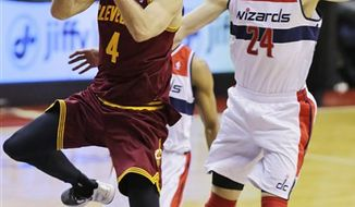Cleveland Cavaliers forward Luke Walton (4) shoots past Washington Wizards forward Jan Vesely (24) in the second half of an NBA game, Wednesday, Dec. 26, 2012, in Washington. The Cavaliers won 87-84. (AP Photo/Alex Brandon)