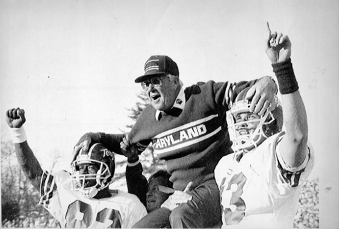 **FILE** Maryland head football coach Joe Krivak is carried off the field on the shoulders of players Gene Thomas (82) and Mark Mason after they beat the University of Virginia, 35-30, at Scott Stadium in Charlottesville, Va., on Nov. 17, 1990. (Associated Press)