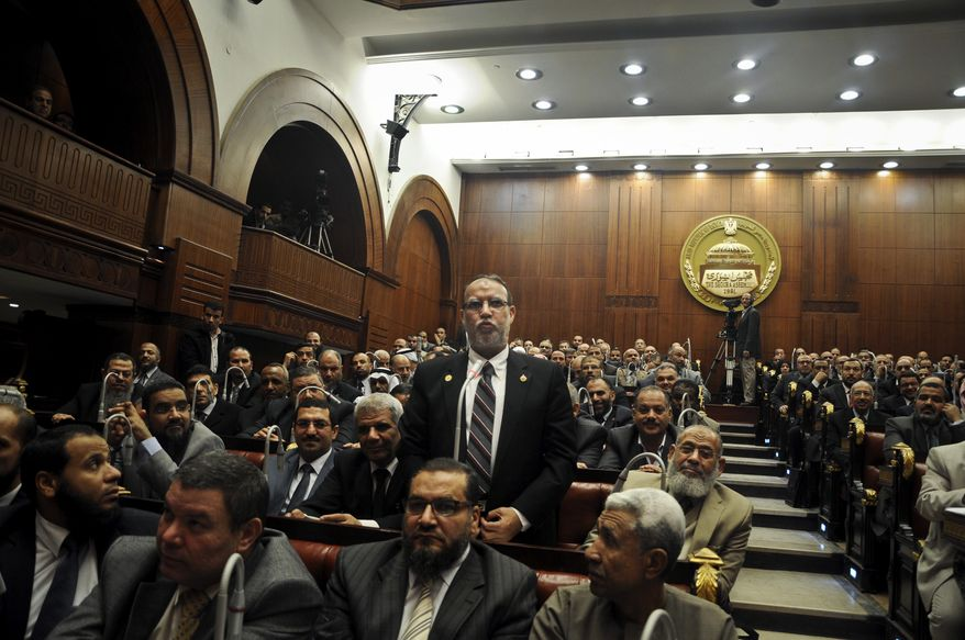 Essam el-Erian, vice chairman of the Freedom and Justice party, speaks during a session at the Shura Council building in Cairo on Dec. 26, 2012. The official approval of Egypt's disputed, Islamist-backed constitution the previous day held out little hope of stabilizing the country after two years of turmoil, and Islamist President Mohammed Morsi now may face a more immediate crisis with the economy falling deeper into distress. (Associated Press)