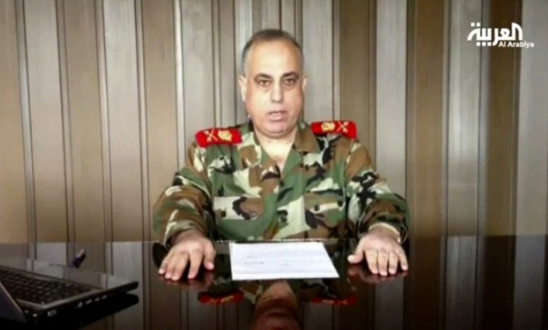 """Maj. Gen. Abdul-Aziz Jassem al-Shallal, who headed Syria's military police, announces on Tuesday, Dec. 25, 2012, that he is joining """"the people's revolution."""" The general the one of the highest-ranking officials to have defected from President Bashar Assad's regime. (AP Photo/Al Arabiya via AP video)"""