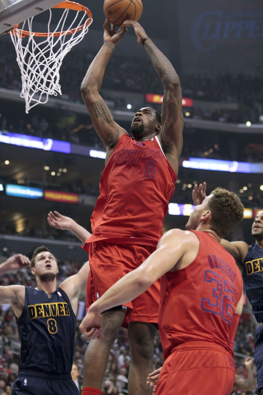 Los Angeles Clippers center DeAndre Jordan (6) drives to the hoop as Denver Nuggets F Danilo Gallinari (8) and Clippers F Blake Griffin look on during the first half of the Clippers' 112-100 win on Dec. 25, 2012, in Los Angeles. (Associated Press)