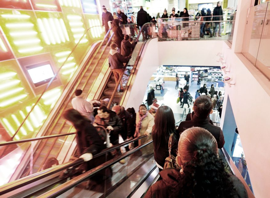 Shoppers navigate their way around Toys R Us in Times Square Wednesday, Dec. 26, 2012, in New York. This holiday season is shaping up to be the weakest since the country was in the middle of a deep recession in 2008.  (AP Photo/Frank Franklin II)