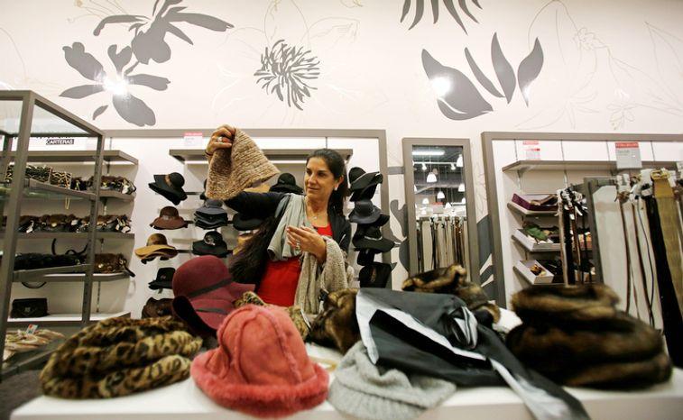 Kiki Infante checks out the merchandise for her Christmas presents in Miami, Thursday, Dec. 20, 2012. (AP Photo/Alan Diaz)