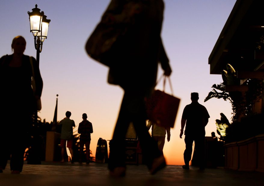 In this Thursday, Dec. 20, 2012 photo, people walk through the Fashion Island shopping center in Newport Beach, Calif. U.S. holiday retail sales this year are the weakest since 2008, after a shopping season disrupted by storms and rising uncertainty among consumers.   (AP Photo/Chris Carlson, File)