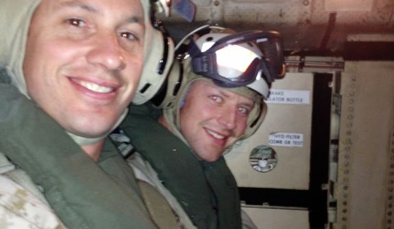 On a COD (Carrier Onboard Delivery) set to land on the USS John C. Stennis Aircraft Carrier is Washington Capitals player Matt Hendricks, right, and U.S. Navy Seal Major Wisecup, at left in the foreground.  (Courtesy of Matt Hendricks)