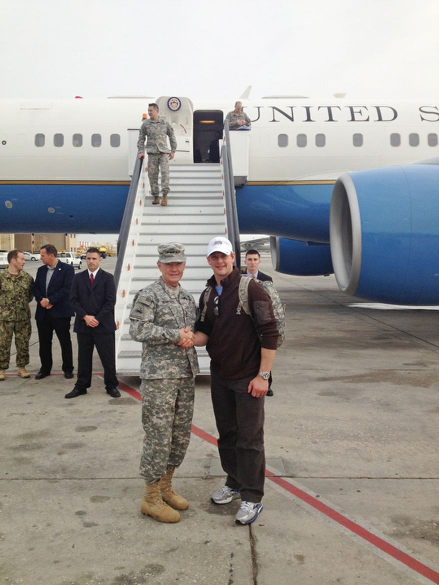 Washington Capitals player Matt Hendricks with Chairman of the Joint Chiefs of Staff Gen. Martin Dempsey in front of Air Force Two.  (Courtesy of Matt Hendricks)