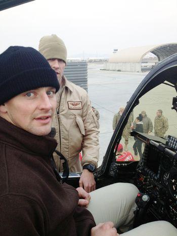 Washington Capitals player Matt Hendricks sits in the Warthog, a fighter jet, during a USO tour.  (Courtesy of Matt Hendricks)