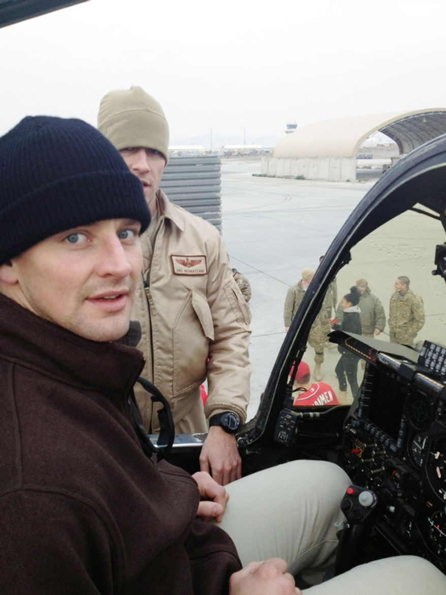 Washington Capitals player Matt Hendricks sits in the Warthog, a fighter jet, during a USO tour.  (Courtesy of Matt Hendricks)