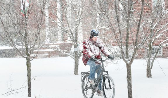 With a bicycle as his only means of transport, Dale Marchant of Winchester, Va. pedals along Valley Ave. in a snowstorm that is expected to dump four or more inches in the Winchester, Va. area, Wednesday, Dec. 26, 2012. (AP Photo/The Winchester Star, Jeff Taylor)